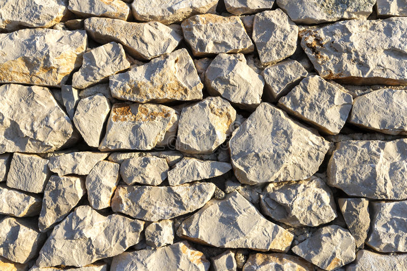 Sunset on surface of stone wall stock image