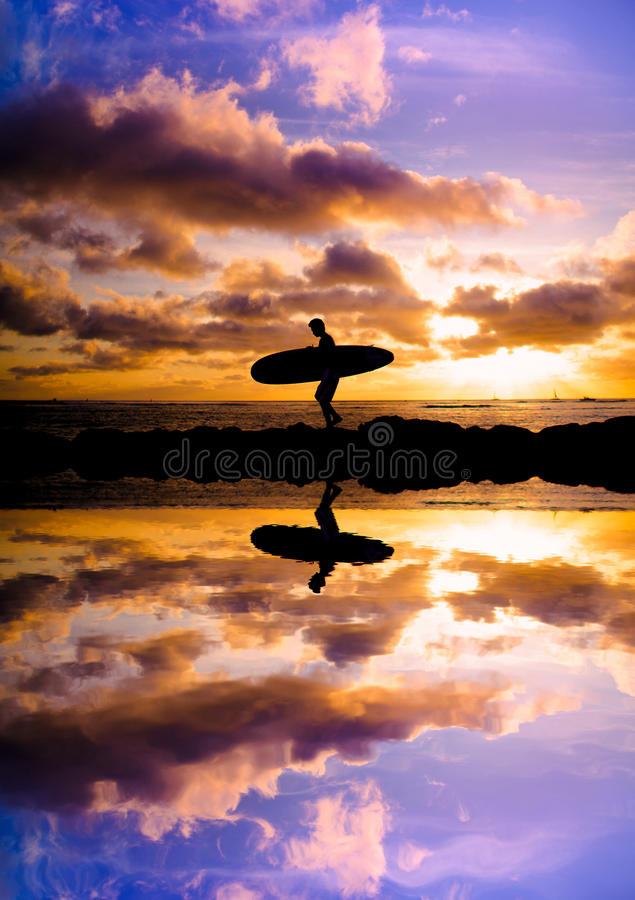 Sunset surfer silhouette reflection stock images