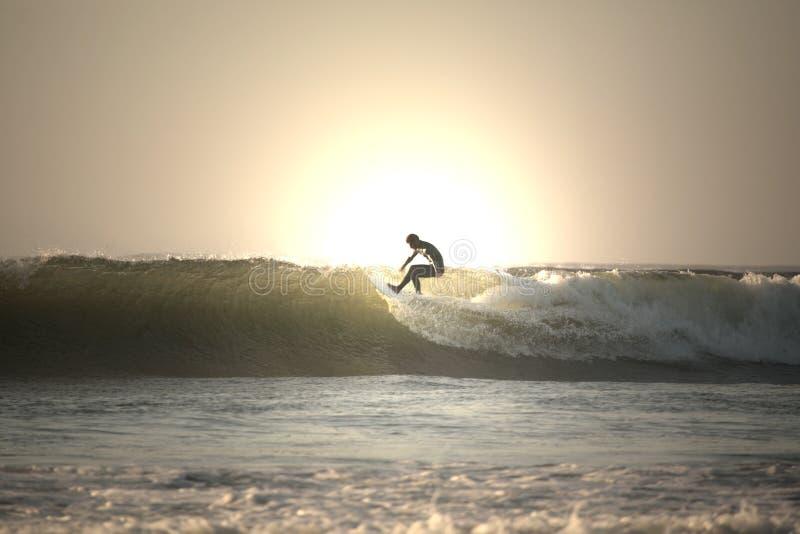 sunset surfera fotografia stock