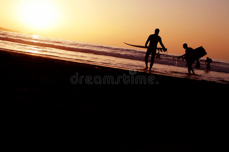 Sunset Surfers royalty free stock images