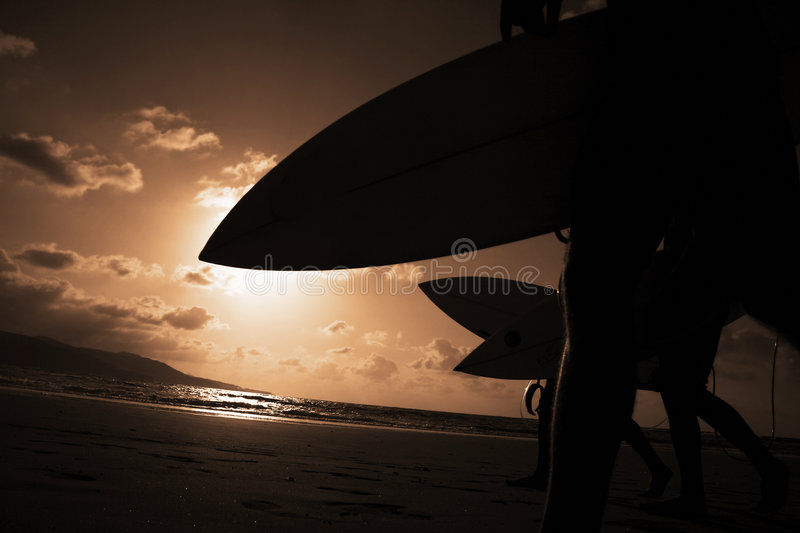 Sunset Surfers stock photography