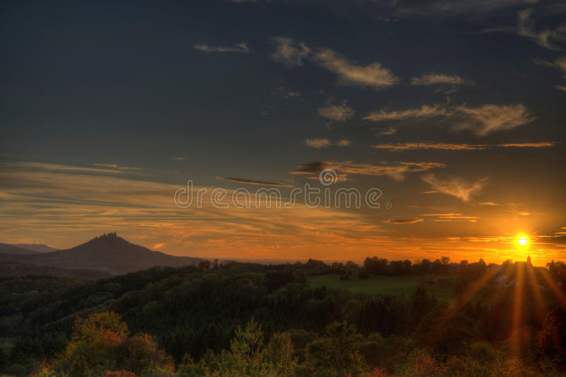 Sunset at the swabian alb with view to the castle Hohenzollern. Picture was taken on a sunny warm autumn day stock photography