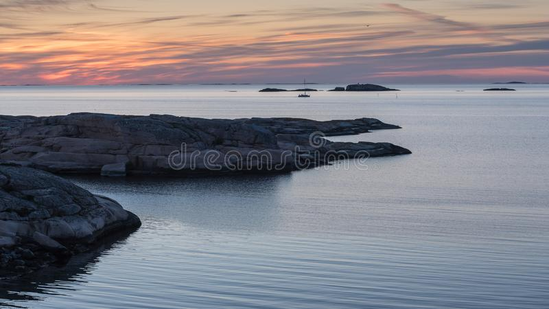 Sunset at Tångevik, on the West Coast of Sweden. Sunset at TÃ¥ngevik, on the West Coast of Sweden, photographed during spring in the nature reserve royalty free stock image