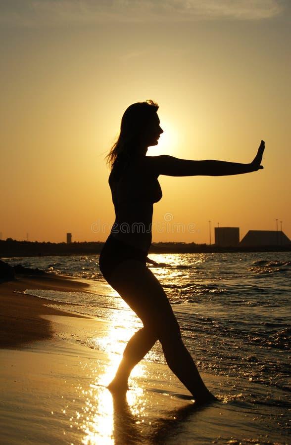 Sunset Tai Chi on a beach stock image