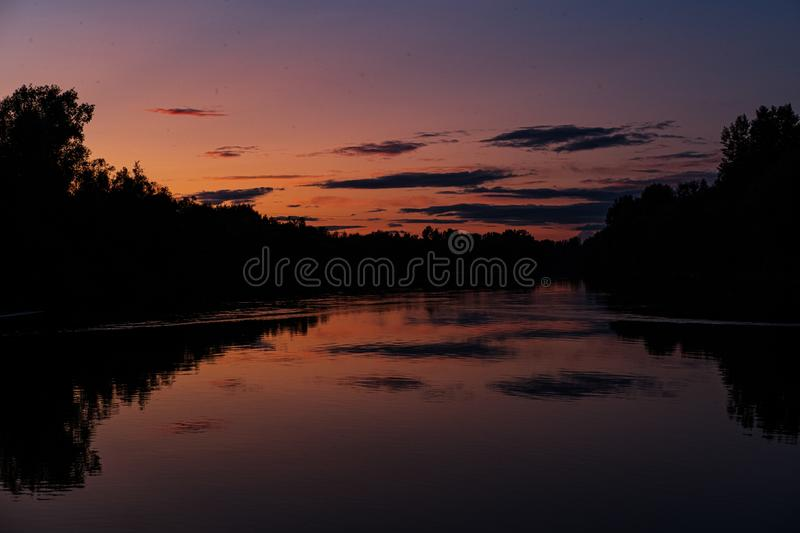 Sunset on the taiga river. Chaya in the north of the Tomsk region stock photography