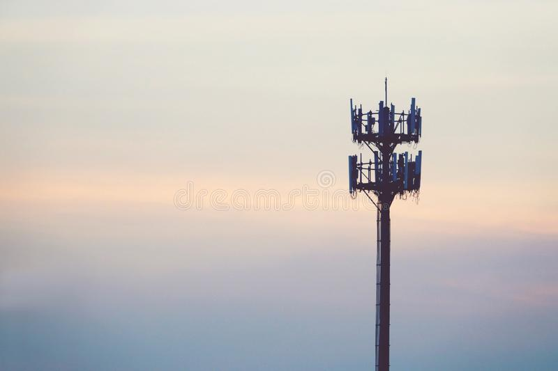 Sunset and Tall mast with cellular antenna.  royalty free stock photos