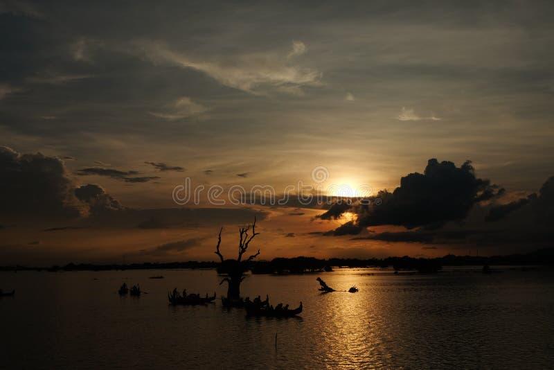 Sunset on the Taungthaman Lake near Ubein bridge, Amarapura in Myanmar. The photo was taken in Oct, 2015 royalty free stock photography