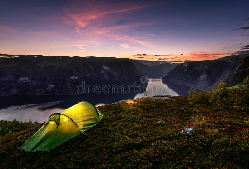 Sunset and Tent in Autumn in Aurlandsfjord, Norway royalty free stock photo