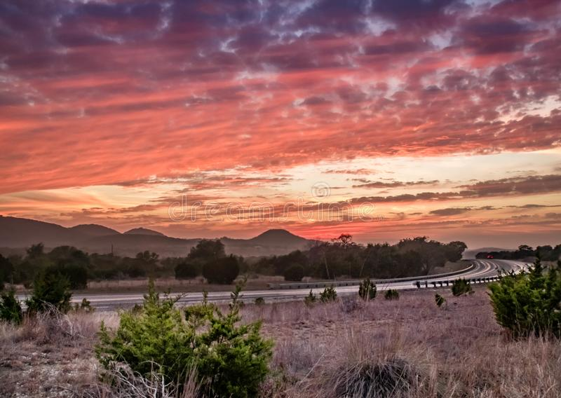 Texas Hill Country sunset. The sunset at Texas Hill Country with Texas State Highway 16 royalty free stock photo