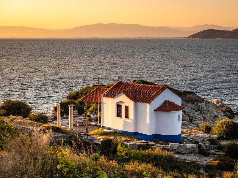 Sunset in Thasos, Greece. Thasos or Thassos Island is a summer destination island in the Aegean Sea popular for sand beaches and clear blue waters stock image