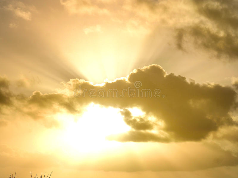 Sunset time with beautiful gold sky and clouds royalty free stock image
