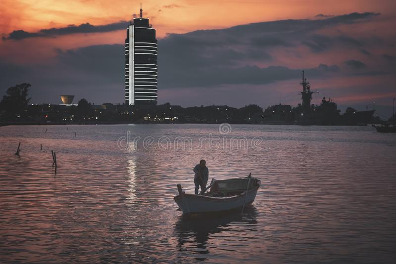 Izmir turkey cloudy day sunset and fisherman royalty free stock photography