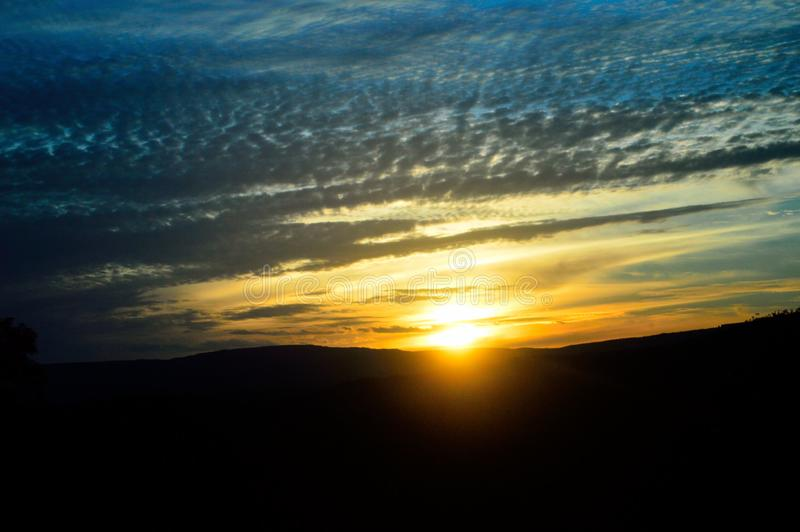 A sunset to enchant our eyes. A special image I saw while traveling. The sun saying goodbye stock image