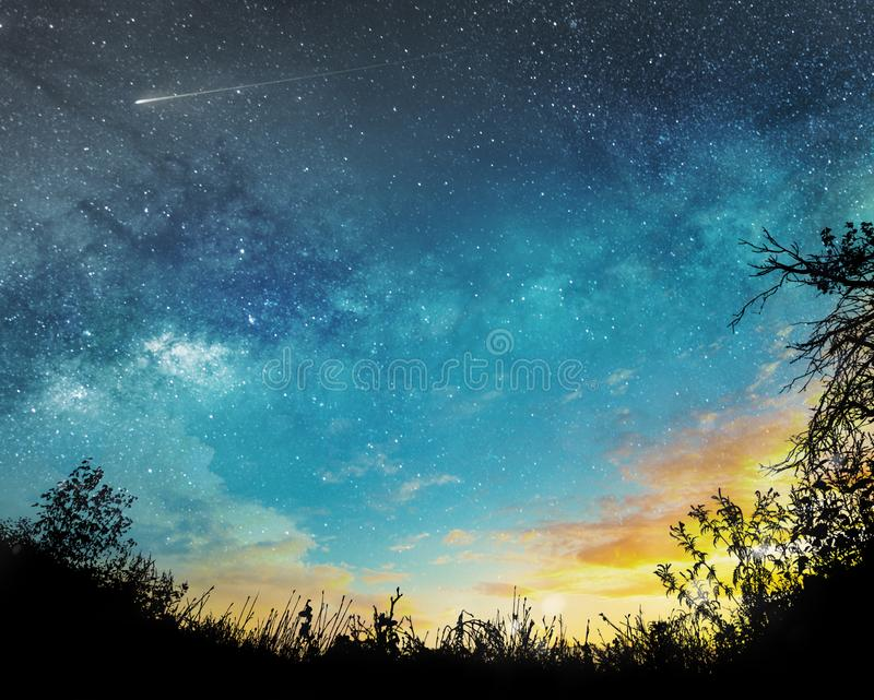 Sunset to night sky. Background with stars, comet and clouds stock images
