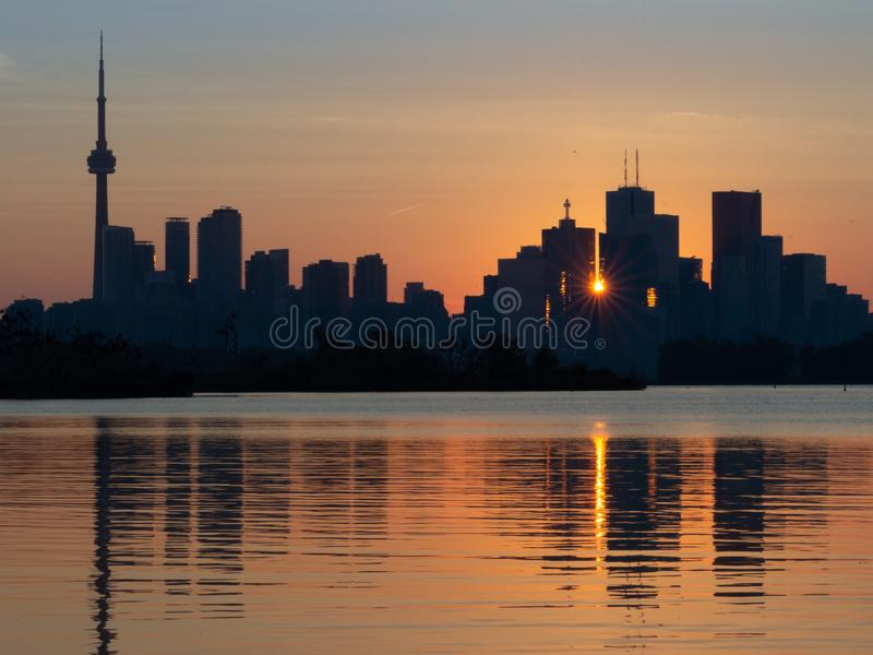 Sunset in Toronto, Ontario, with reflection in the lake royalty free stock photography