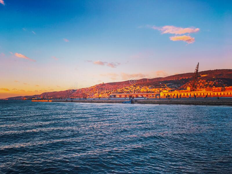 Sunset town view in Trieste, Italy stock photo