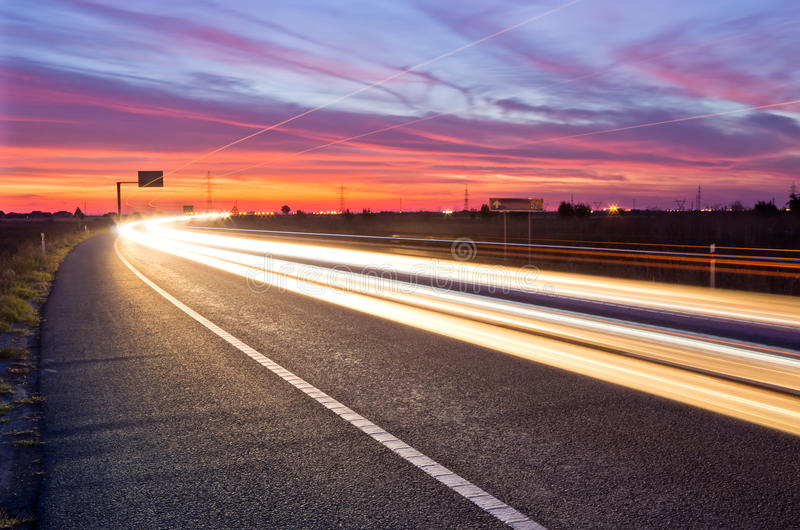 Sunset traffic. Long exposure of traffic at sunset with light streaks royalty free stock photos