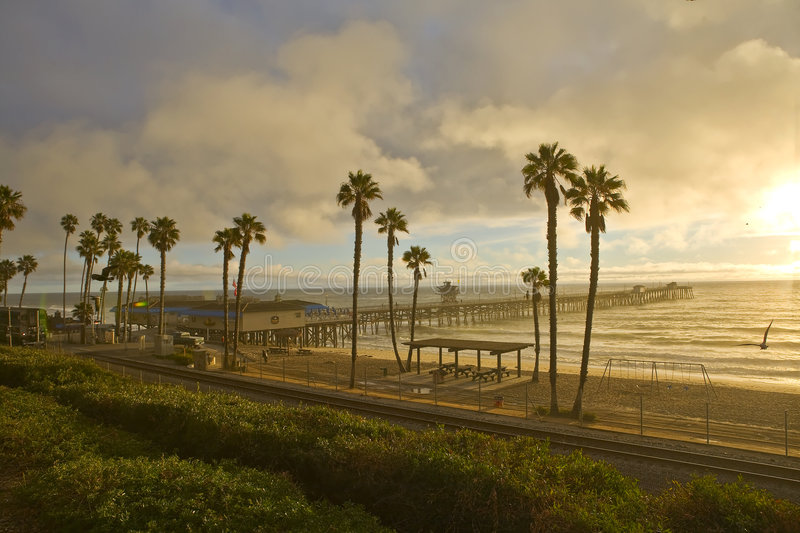 Sunset Train at San Clemente Pier. During Summer stock photos