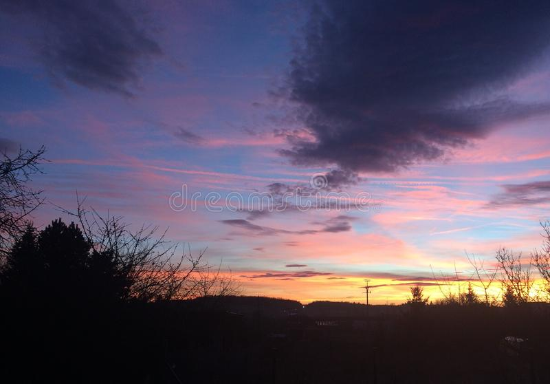 Sunset trees dawn sky clouds royalty free stock photography