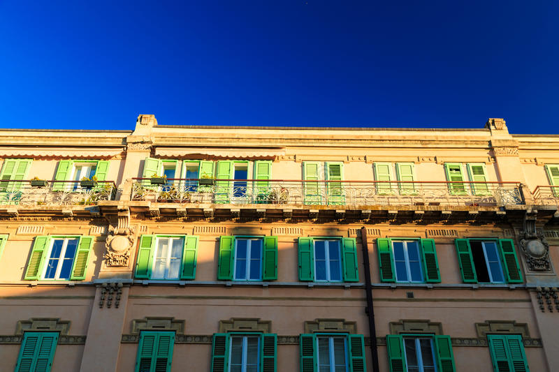 Sunset in Trieste. Sun goes down and paints colors on the wall of the buildings of Trieste royalty free stock photos