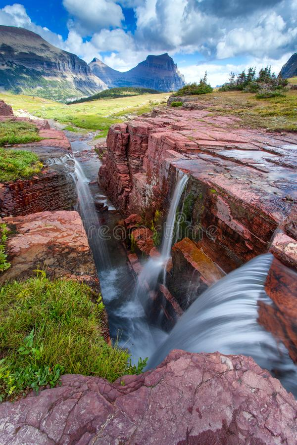 Sunset at Triple Falls in Glacier National Park, Montana, USA stock images