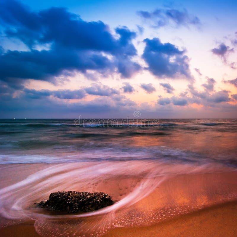 Sunset At Tropical Beach. Rocks At The Ocean Coast Stock