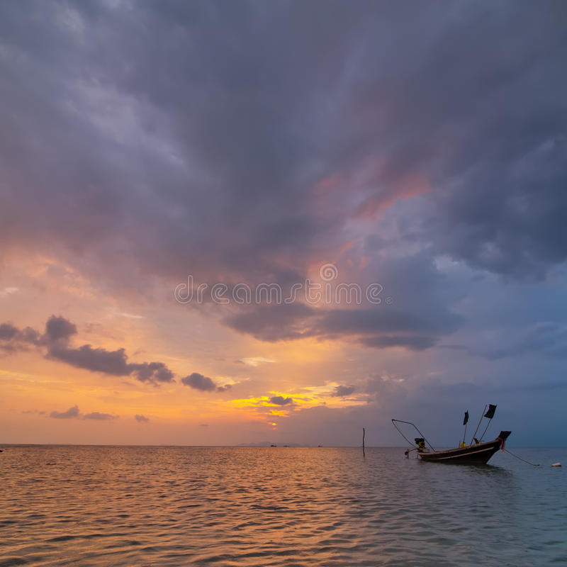 Sunset At Tropical Beach. Ocean Sandy Coast Under Evening