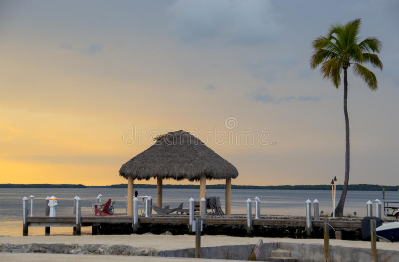 Sunset on a tropical resort royalty free stock images