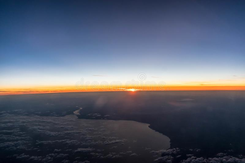 Sunset from a height of 10 km royalty free stock image