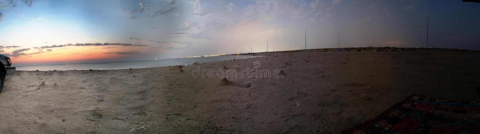 Sunset and twilight on the beach royalty free stock images