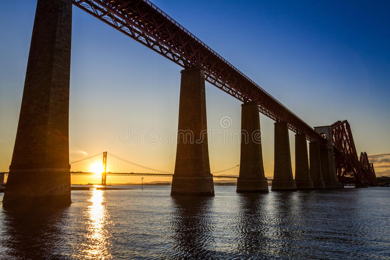 Sunset between the two bridges in Scotland royalty free stock image