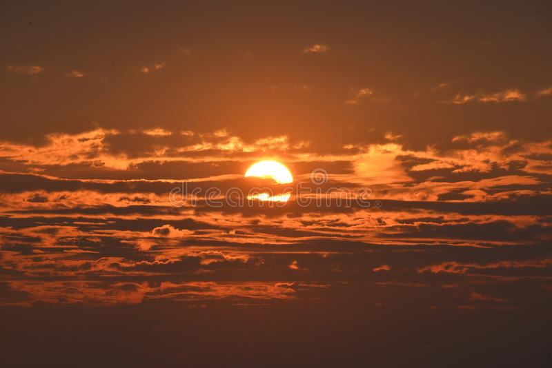 Sunset Under Cloudy Clouds stock images