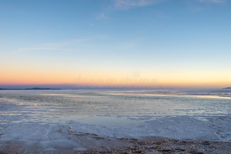 Sunset at Uyuni Salt Flats in Bolivia, the incredible salt desert in South America royalty free stock photos