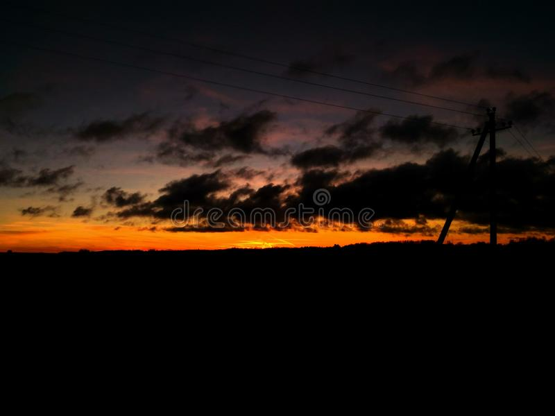 Sunset. Very beautifyl sunset in estonia with dark clouds royalty free stock image
