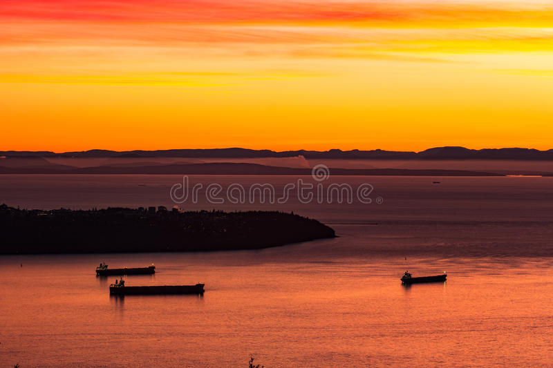 Cargo ships off Point Grey, Vancouver, British Columbia, Canada royalty free stock image