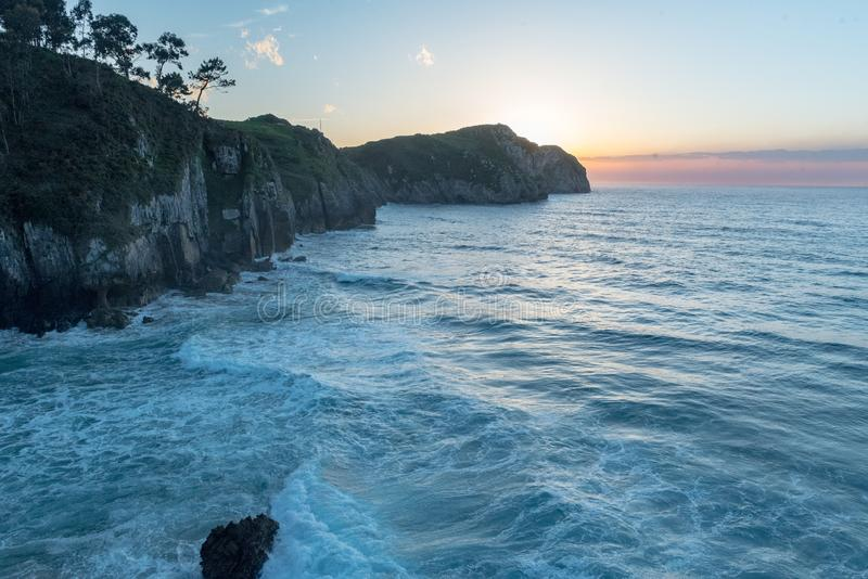 Sunset  in Vidiago beach in Llanes, Asturias, Spain. Amaizing Sunset in Vidiago beach in Llanes, Asturias, Spain stock photography