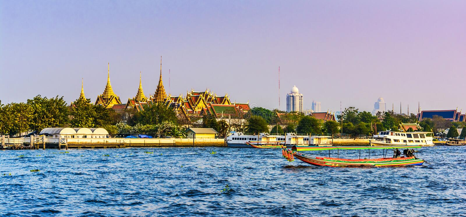 Sunset view across the Grand Palace, with the Chao Praya River i stock photography