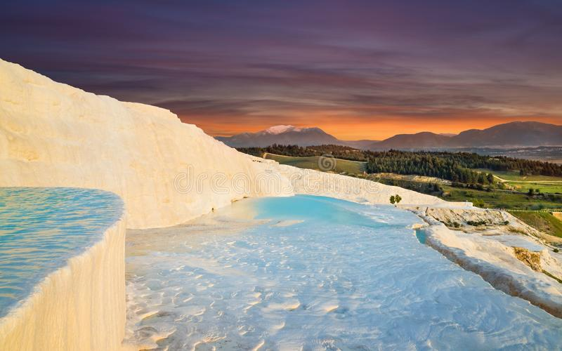 Sunset view of amazing Pamukkale. Travertine terrace formations with flowing thermal springs in Pamukkale most visited attraction. Sunset view of amazing stock image