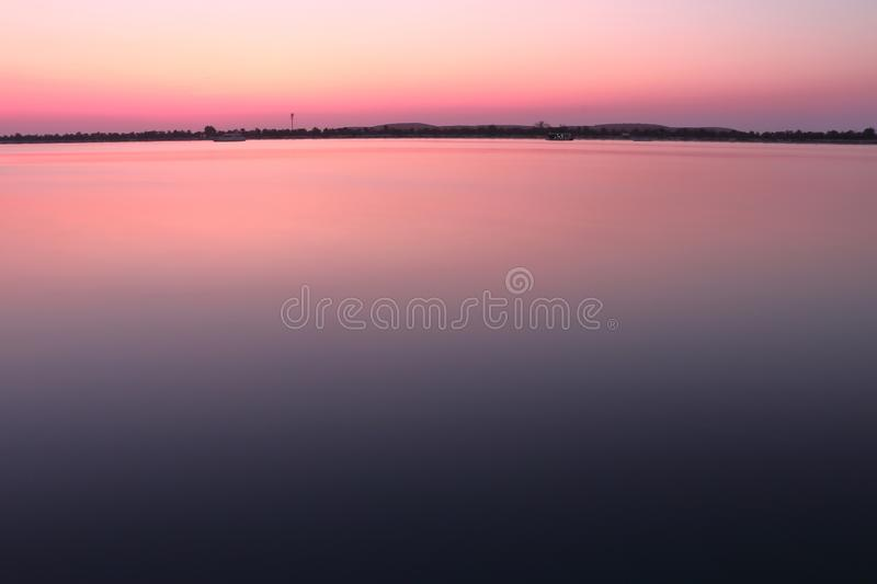 SUNSET VIEW FROM SEA SHORE - LONG EXPOSERE SHOT royalty free stock photography