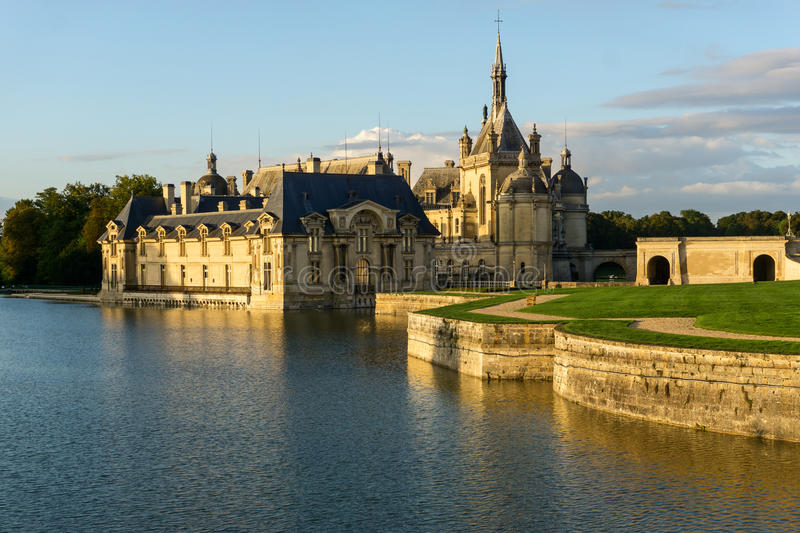 Sunset view of beautiful Chantilly castle royalty free stock photos