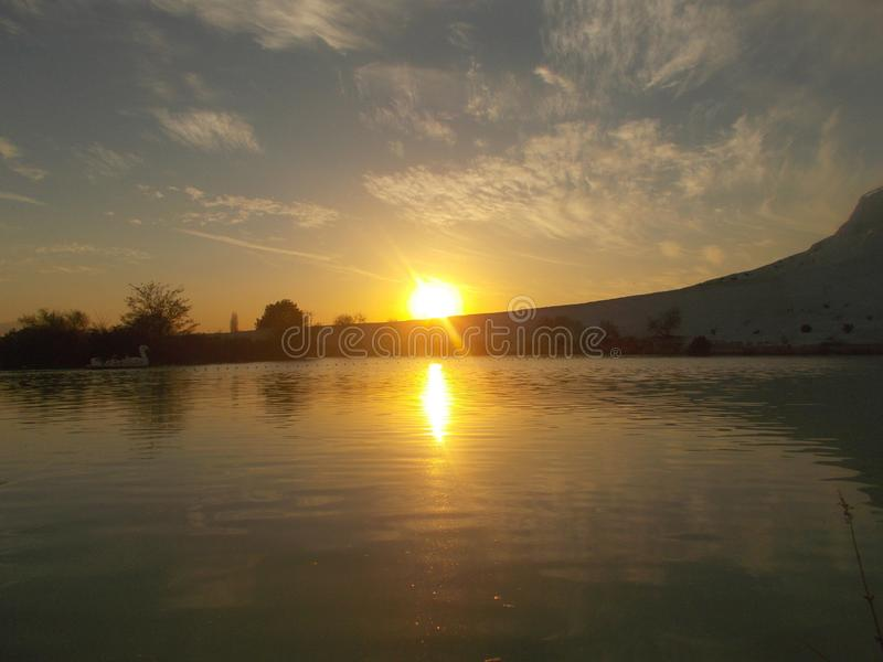 Sunset In Pamukkale With River Landscape. Sunset view captured in Pamukkale, Denizli, with river landscape and sunshine brilliancy royalty free stock images