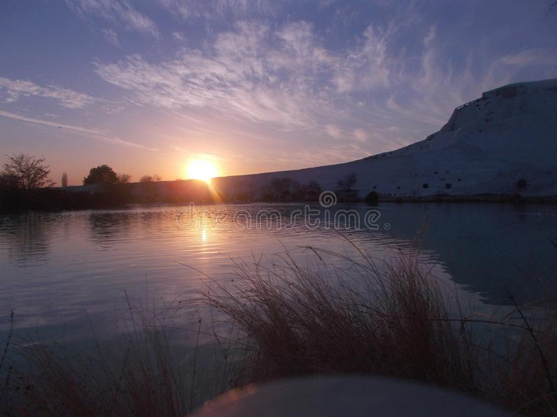Sunset In Pamukkale With River Landscape. Sunset view captured in Pamukkale, Denizli, with river landscape and sunshine brilliancy stock image