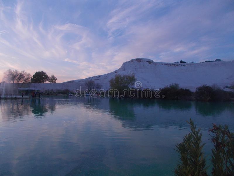 Sunset In Pamukkale With River Landscape. Sunset view captured in Pamukkale, Denizli, with river landscape and sunshine brilliancy stock photos