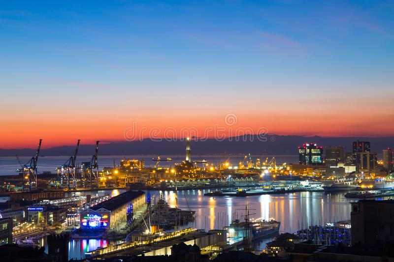 Sunset view of the city of Genoa, Italy. The harbor with Lanterna, the symbol of the city. royalty free stock images