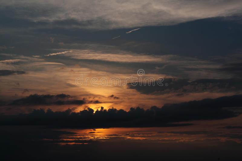 Sunset - view of cloudy sky and setting sun royalty free stock photos