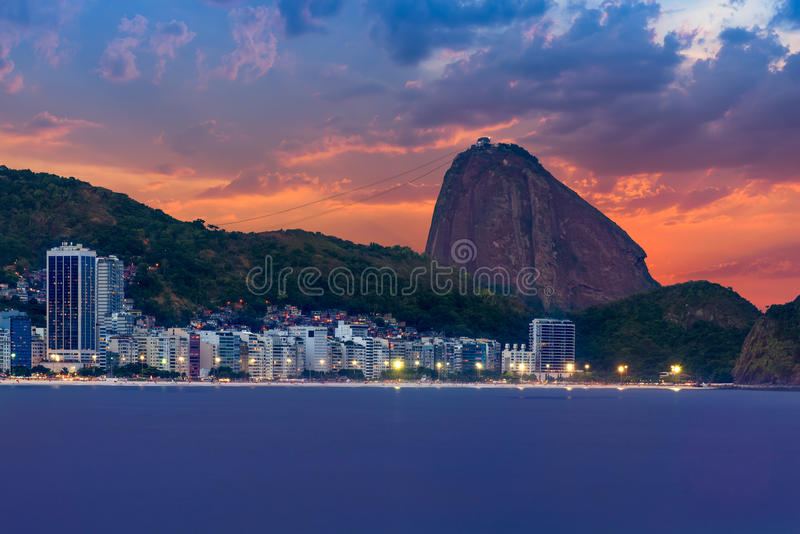 Sunset view of Copacabana, mountain Sugar Loaf in Rio de Janeiro. Brazil royalty free stock photos