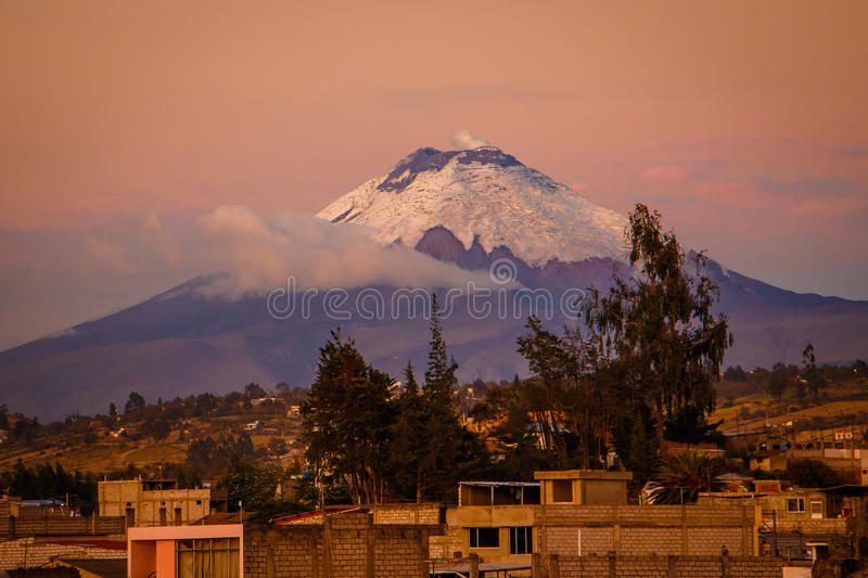 The sunset view of Cotopaxi volcano from Latacunga town, Ecuador royalty free stock photo