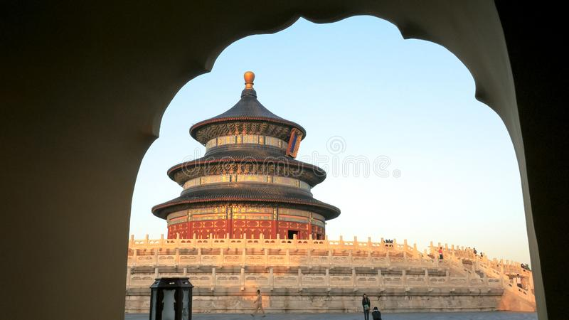 Sunset view of a couple at temple of heaven in China framed by an arch stock photos
