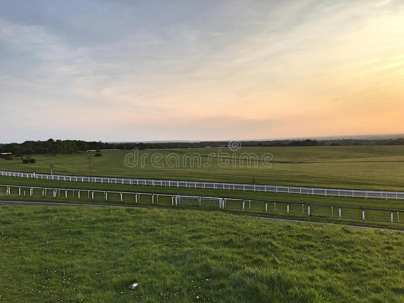 Sunset at racecourse. Sunset view at a epsom downs racecourse stock image