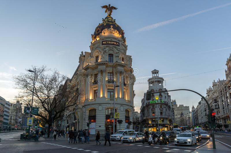 Sunset view of Gran Via and Metropolis Building in City of Madrid, Spain royalty free stock images